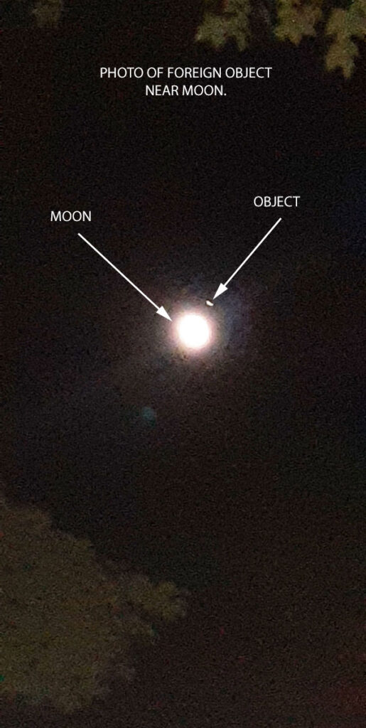 PHOTO OF FOREIGN OBJECT NEAR MOON.