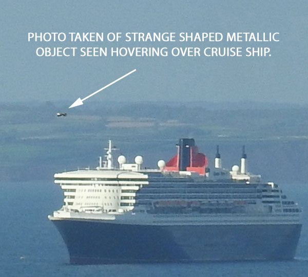 PHOTO OF STRANGE SHAPED METALLIC OBJECT SEEN HOVERING OVER CRUISE SHIP.