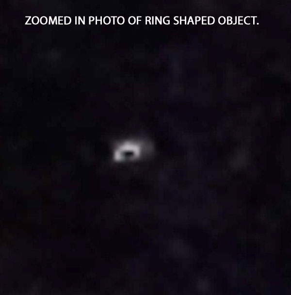 ZOOMED IN PHOTO OF OF RING SHAPED OBJECT.
