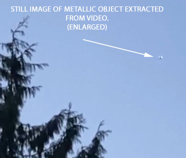 STILL IMAGE OF METALLIC OBJECT EXTRACTED FROM VIDEO. (ENLARGED.)