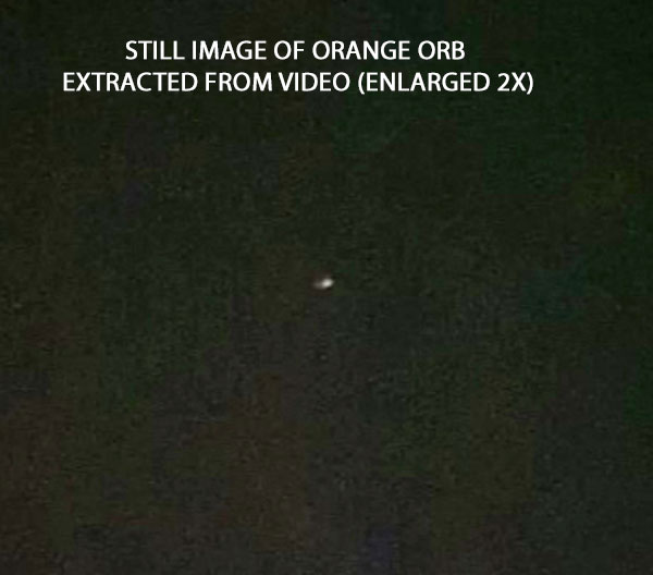 STILL IMAGE OR ORANGE ORB EXTRACTED FROM VIDEO. (ENLARGED 2X.)
