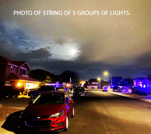 PHOTO OF STRING OF 5 GROUPS OF LIGHTS.
