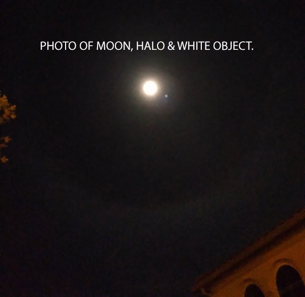 PHOTO OF MOON, HALO & WHITE OBJECT.