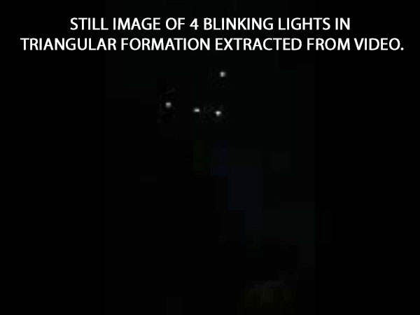 STILL IMAGE OF 4 BLINKING LIGHTS IN TRIANGULAR FORMATION EXTRACTED FROM VIDEO.