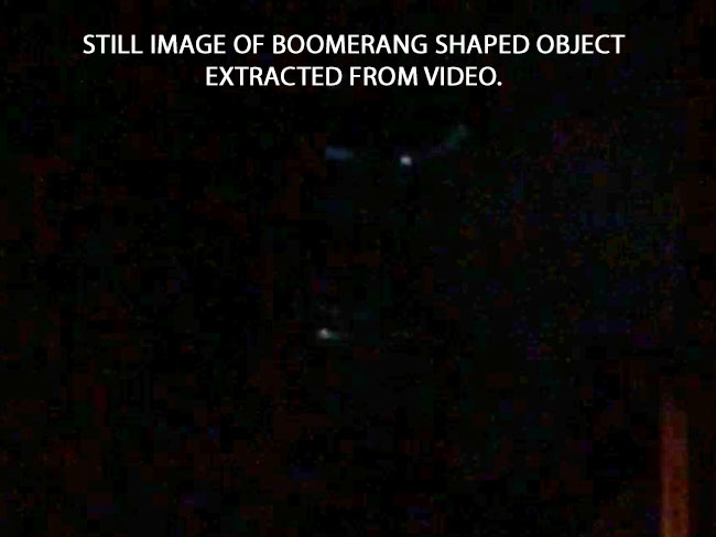 STILL IMAGE OF BOOERANG SHAPED OBJECT EXTRACTED FROM VIDEO.