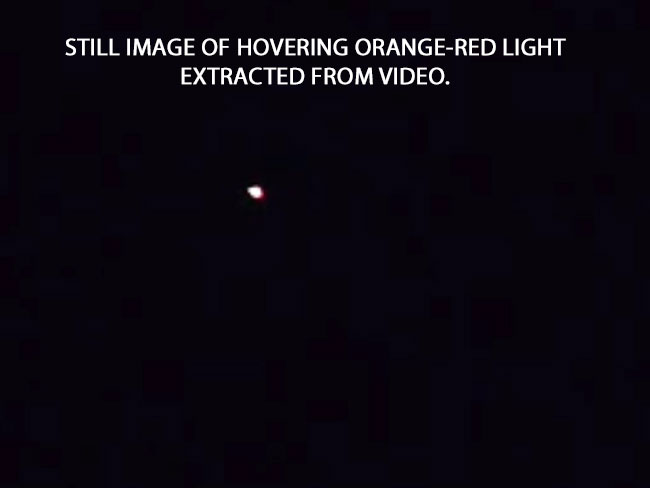 STILL IMAGE OF ORANGE-RED LIGHT EXTRACED FROM VIDEO.