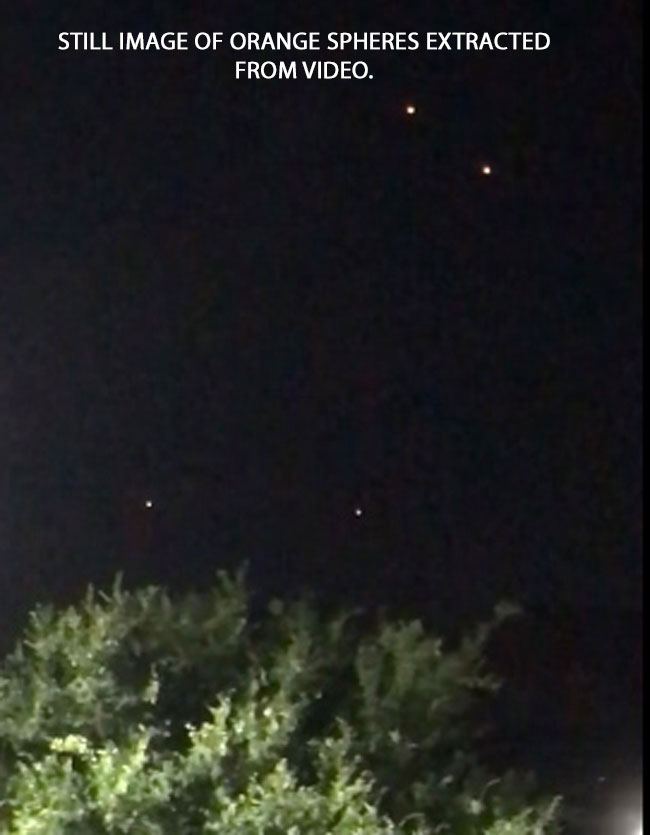STILL IMAGE OF ORANGE SPHERES EXTRACTED FROM VIDEO.