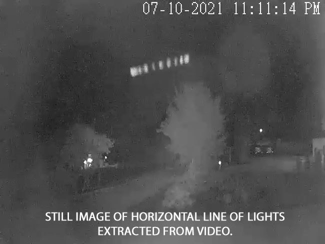 STILL IMAGE OF LINE OF LIGHTS EXTRACTED FROM VIDEO.