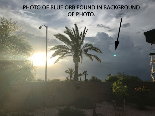 BLUE ORB FOUND IN THE BACKGROUND OF PHOTO.