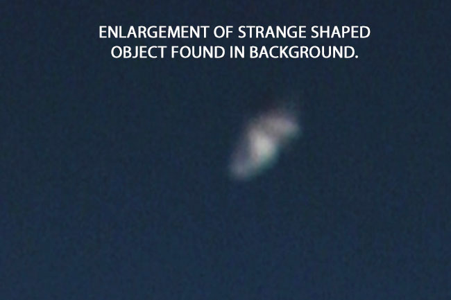 ENLARGEMENT OF STRANGE SHAPED OBJECT FOUND IN PHOTO BACKGROUND.