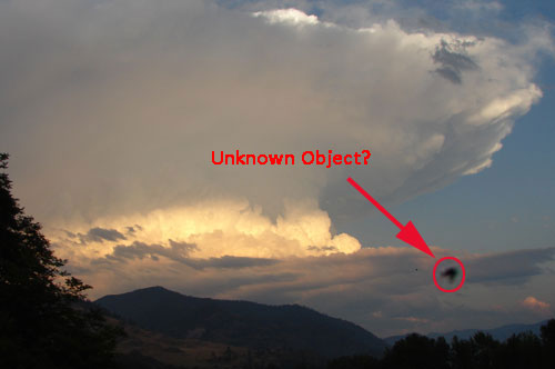 Photo of Unknown Object Near Thunderstorm.
